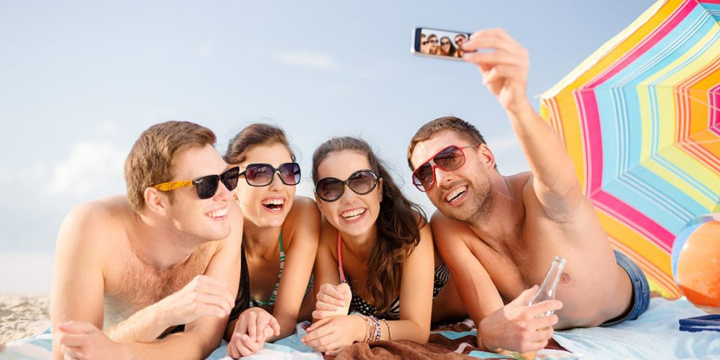 Friends taking a photo at the beach